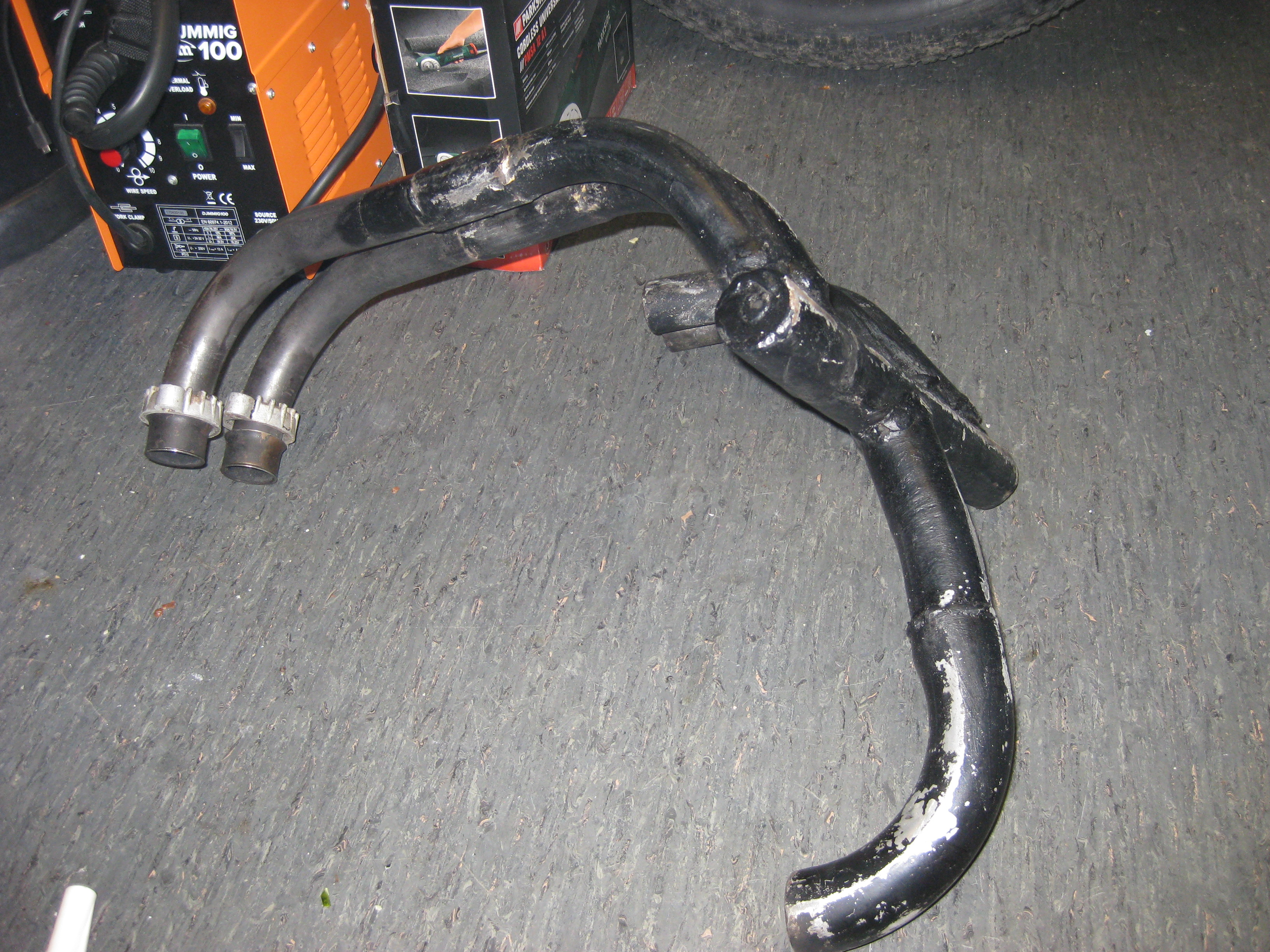 The original exhaust system that had been removed from the Kawasaki Gpz600r.